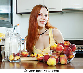 long-haired girl in yellow cooking with peaches