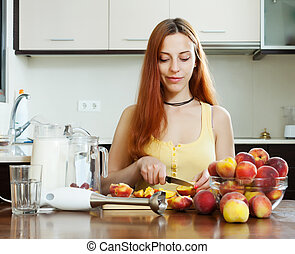long-haired girl in yellow with peaches at home