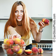 long-haired girl taking peaches