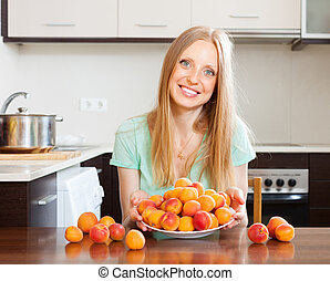 long-haired girl with apricots