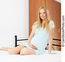 Long-haired pregnant woman