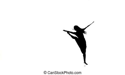 Long-haired woman dancer dancing contemporary dance, jumps and makes split, on white, silhouette, slow motion