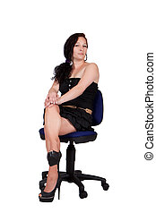 Long-haired woman on a chair - Long-haired woman in black...