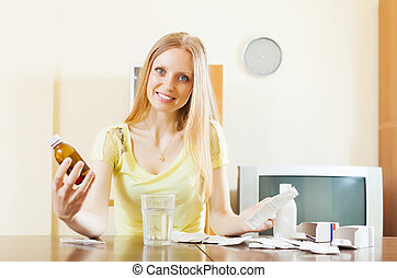 Long-haired woman with medications