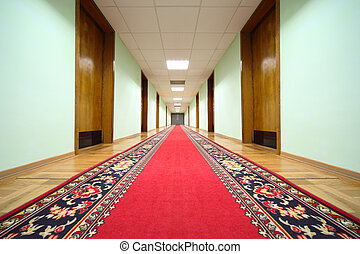 long hallway with brown wood doors, end of corridor, red...