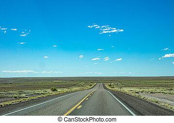 Long highway in the american desert, blue sky
