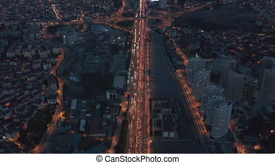 Long Highway or Freeway at Night in Istanbul Financial District City endless intro the distance with Traffic Jam and Red lights, Aerial View