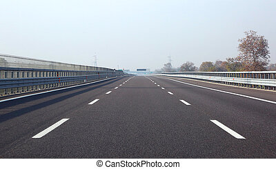 long highway with three lane without cars