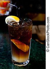 Long Island Iced Tea on the background of the bar