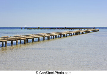 Long jetty over coral reef