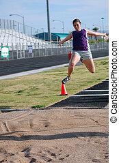 Long Jump - Teenage girl practicing long jump