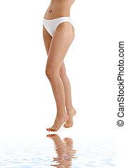 long legs in bikini panties on white sand - picture of long...