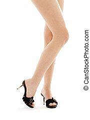 long legs in black kinky shoes over white