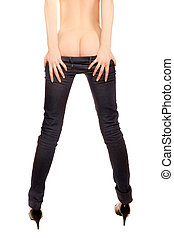 Long legs of a woman in high heels taking off her jeans