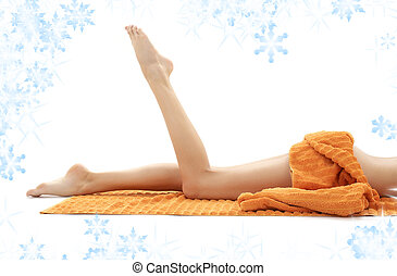 legs of relaxed lady with orange towel