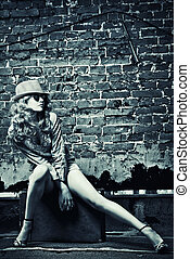 long legs - Portrait of a beautiful young woman sitting on...