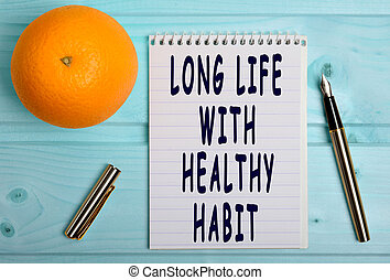 Long life with healthy habit words on notebook