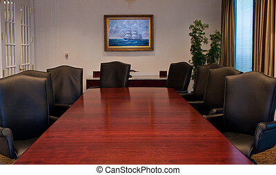 Long Mahogany Conference Table - A long conference table in...
