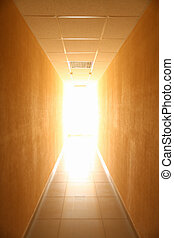Long narrow tunnel with light in the end