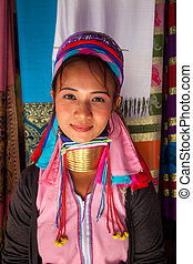 Long Neck woman in traditional costumes in Ban Huay Sua Tao...