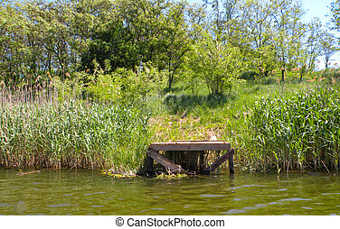 Long Old wooden pier and beautiful lake. Empty on small country lake. of summer. Place for text and fishing. View from lake