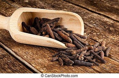 Long pepper or Piper longum on wooden table