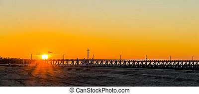 long pier at sunset on the beach of Blankenberge, Belgium, sunset with a colorful sky