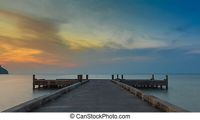 Long pier leading into the seacoast