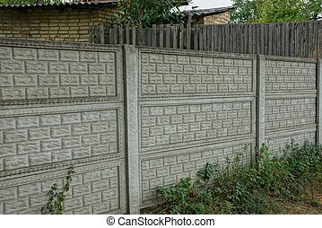 concrete gray fence on a rural street