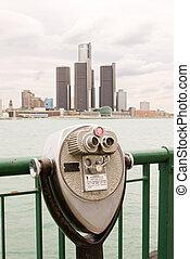 Long range binoculars on river bank - Old worn long range...