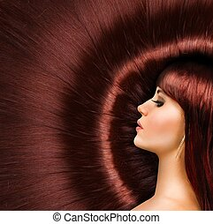 Long red shiny hair of a beautiful girl