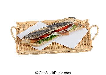 Long sandwich served on wicker tray