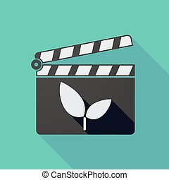 Long shadow clapper board with a plant