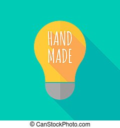Long shadow light bulb icon with    the text HAND MADE