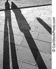long shadows on sidewalk