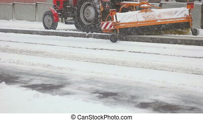 Long shot of tractor cleaning up tram station - Panned and...