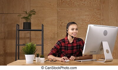 Beautiful freelancer female talking in a video conference on...
