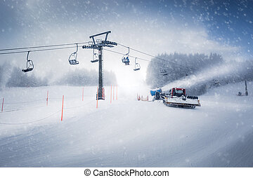 long ski lift line and the working snow cannon on Austrian Alps