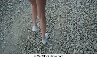 Long Slim Beautiful Female Legs In Sneakers Walking On The Rocky Road, Follow Me Concept, Brunette Woman Leading By Hand Her Lover