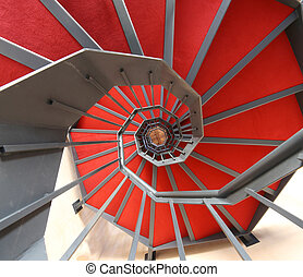 spiral staircase with red carpet