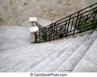 Delightful Long Staircase Descent In Gray Marble With Black Iron Railing