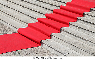 long staircase with a luxurious red carpet