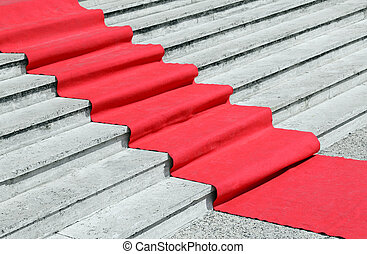 staircase with a luxurious red carpet to welcome VIPs