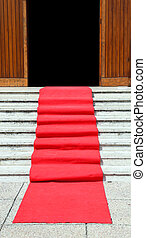long staircase with a luxurious red carpet toward the open door