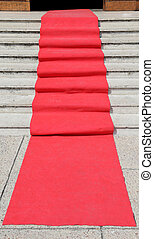 staircase with red carpet and the access door open