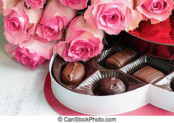 Long Stem Pink Roses with a Heart Shape Box of Chocolate Candy