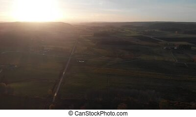 Long Straight Road In Vast Green Landscape at Sunset, Aerial. High quality 4k footage