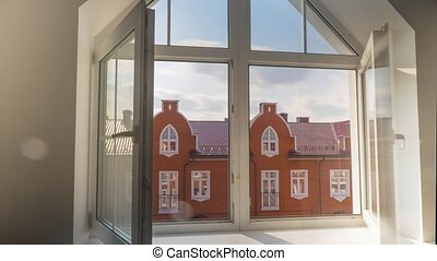 Long sunny time lapse video of window casements openings and closing by breeze