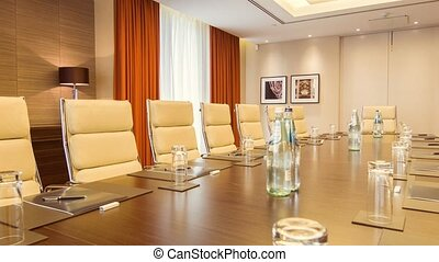 Long table standing in a big conference room