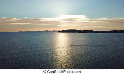 Long-tail boat in sunset at the beautiful ocean in Krabi,...